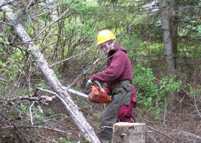 Woman using chainsaw in forests