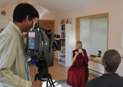 Ven. Chodron drinking tea in front of camera