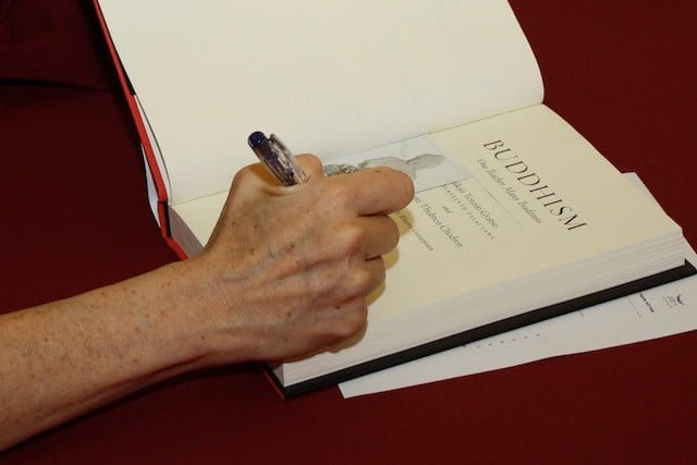 Venerable Chodron signs her book for a student.
