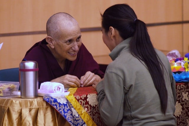 Venerable Chodron greets a student at Singapore teachings.