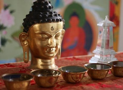 buddha with water bowls