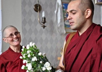 Ven. Tenzin from Russia makes an offering of flowers to the community.