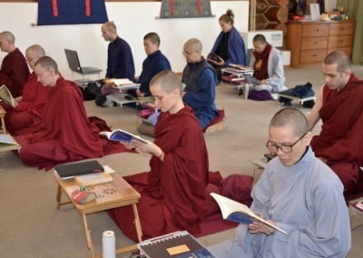 nuns and lay people reciting in meditation hall