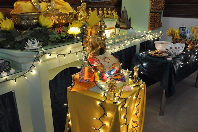 Buddhist statue surrounded with lights