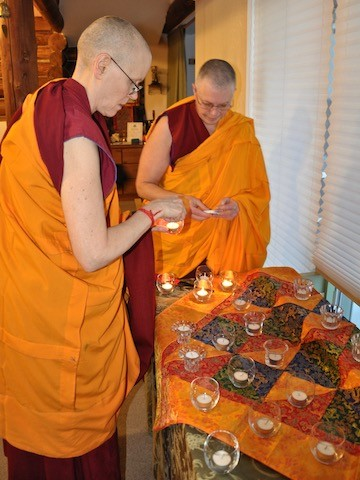 Vens. Tarpa and Yeshe prepare candles for a procession of lights.