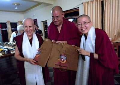 Khen Rinpoche Jangchup Choeden, abbot of Ganden Shartse, offers jholas to mark the formation of a new Gelug International Foundation.