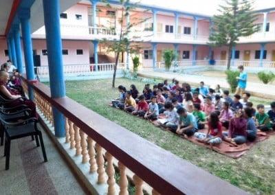 students listening to nun