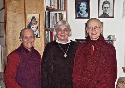 Three nuns—two Buddhist, one Catholic—face the camera.