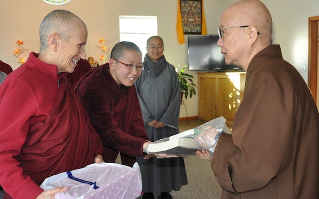 Chinese and Tibetan nuns exchange gifts.