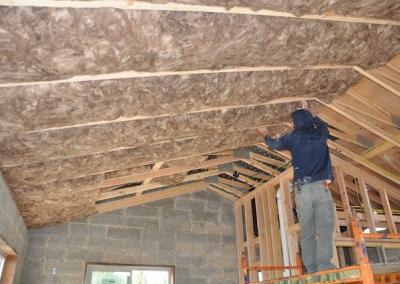Brandon installs insulation.