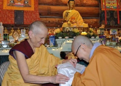Ven. Thien makes a ceremonial offering to Ven. Chodron.