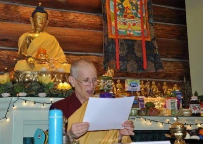 In a dedication of merit, Ven. Chodron reads out the names of Singapore benefactors.