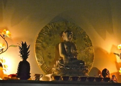 The Buddha lit by lotus lamps.