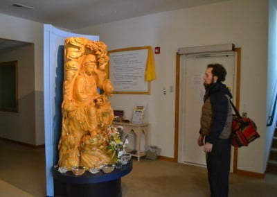 Elijah says goodbye to Kuan Yin.