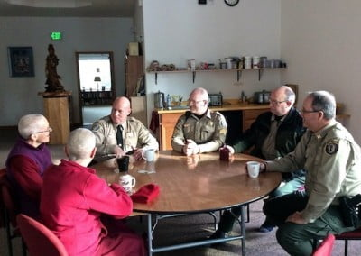 Sherriff Alan Botzheim and his deputies share amazing stories with Vens. Chodron and Semkye.