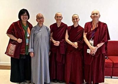 nuns and lay woman posing together