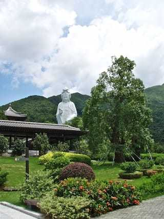 Towering statue in landscape