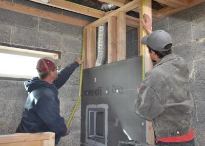 Eric and Brandon lay the foundation for the upstairs shower tiles.