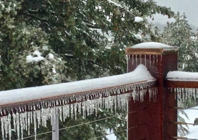 Vanishing relics of an ice storm decorate the decks and railings.