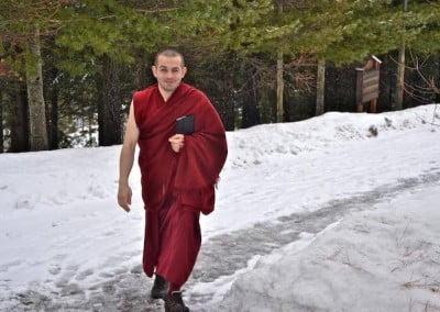 Monk walking in snow