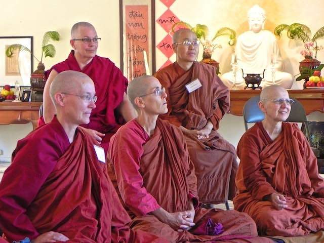 Nuns sharing the Dharma together.