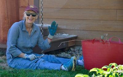 Smiling Sherran works in the garden.