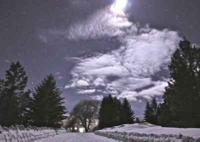 Like an illusion, Venerable Chodron's cabin is seen on a starry full moon night.