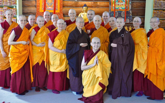 Abbey sangha with the Buddha and new nun