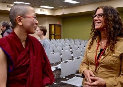 Ven. Damcho connects with Professor Laura Templeman who arranges Ven. Chodron's talks at the college each year.