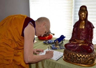 Ven. Chodron signs the ordination certificate.