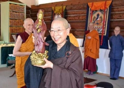 Ven. Jendy with her offering of a Kuan Yin from Ven Nyima
