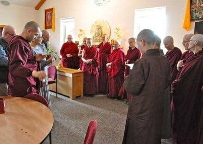 The next day, guests to the ordination make a food offering to the sangha.