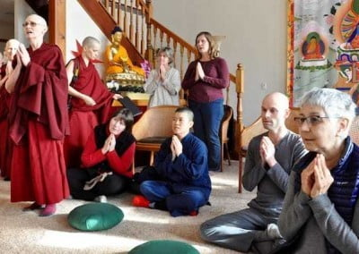 The guests and the sangha sing praises to the Buddha.