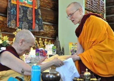 After the puja, Ven. Tarpa makes an offering to Ven. Chodron on behalf of the entire community.