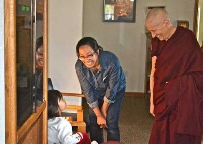 Ven. Chodron says hello to Belinda and her young daughter Kayla.
