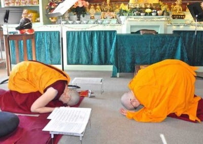 Vens. Jigme and Chonyi bow to one another.