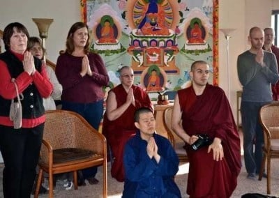The guests chant with the sangha during the ceremony.