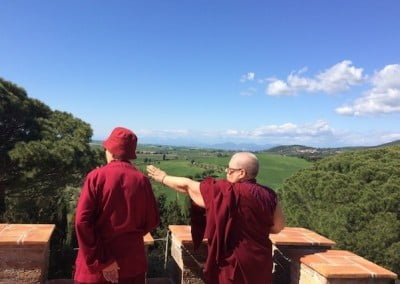 On a tour of the center, Ven. Siliana shows Ven. Chodron the view from the turret.