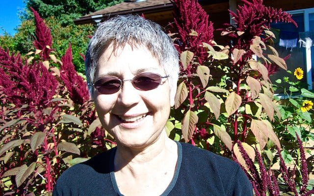 Tanya in front of amaranth blooms