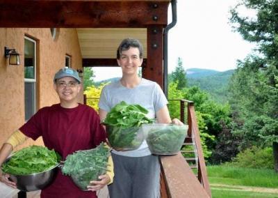 Nun and laywoman holding lettuce
