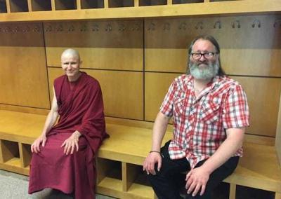 monk and lay man sitting
