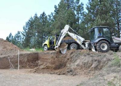 Despite the small size of the house, large amounts of soil are removed to give the crews plenty of space to navigate around the site.