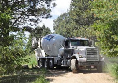 The concrete truck driver manages to get around the tight corner by the Meditation Hall.