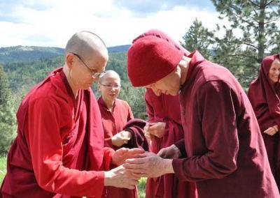 Monk and nun lighting incense