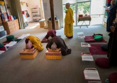 nuns bowing in meditation hall