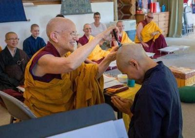 Ven.Chodron shaves off the last tuft of hair.