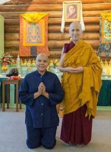 laywoman kneeling next to nun