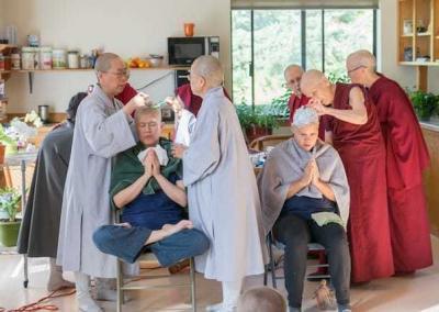 nuns shaving heads of two laywomen