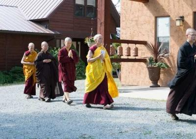 monastics walking in a line