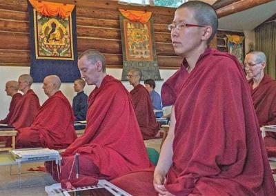 monastics sitting in meditation